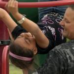 Ethan McCord and daughter Mikayla in a Wichita, Kansas playground, in a scene from the film.
